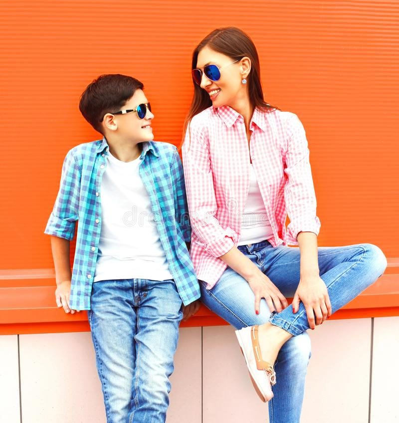 Fashion smiling mother with son teenager in a sunglasses royalty free stock photography