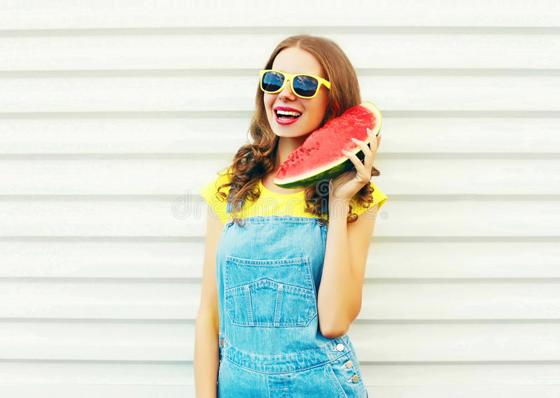 Fashion smiling young woman holding slice of watermelon in hands stock photo