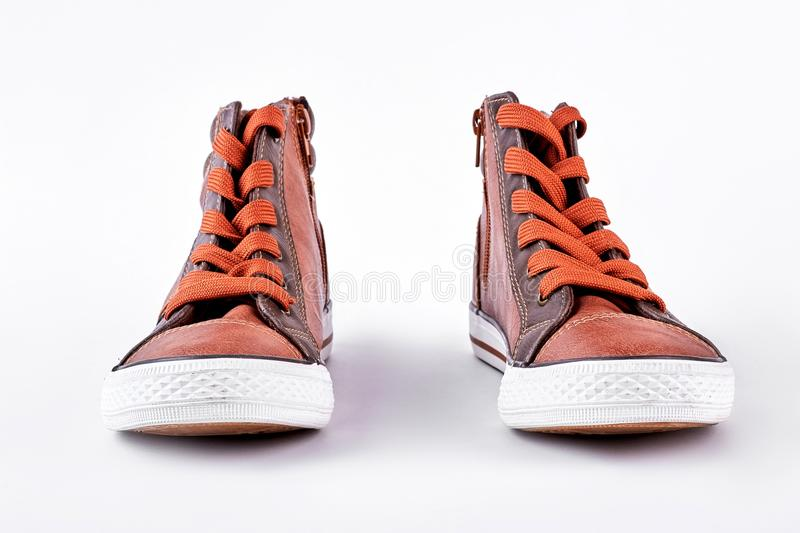 Fashion sport sneakers, white background. Brown sport shoes for training in gym, front view. High quality sport shoes on sale stock image