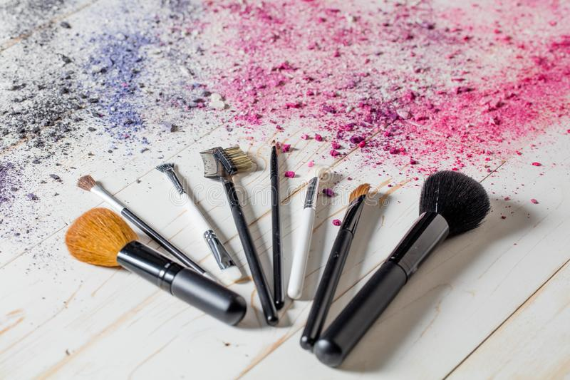 Fashion still life with makeup brushes with explosion of colors royalty free stock photos