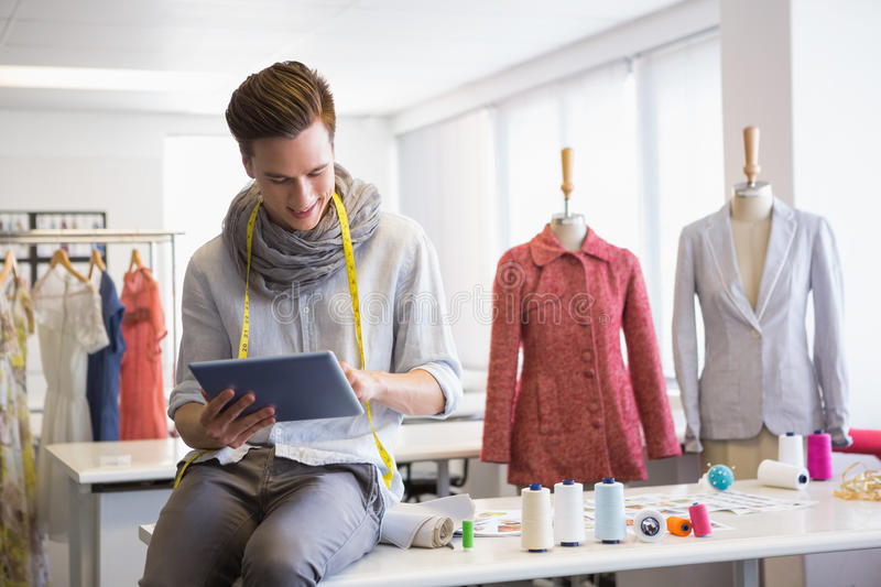 Fashion student working on tablet computer royalty free stock photography