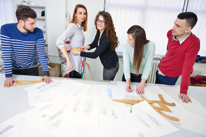 Fashion students working as a team at the college stock images