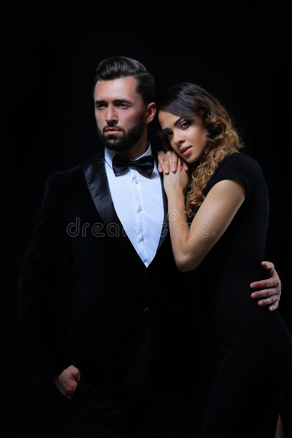 Fashion studio photo of beautiful couple in elegant clothes stock images
