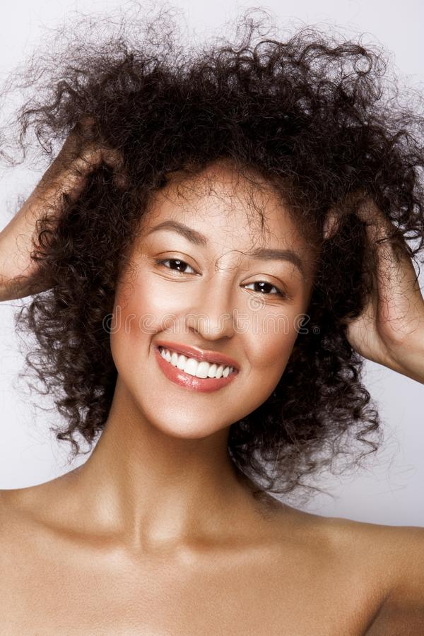 Fashion studio portrait of beautiful african american woman with perfect smooth glowing mulatto skin, make up stock photos