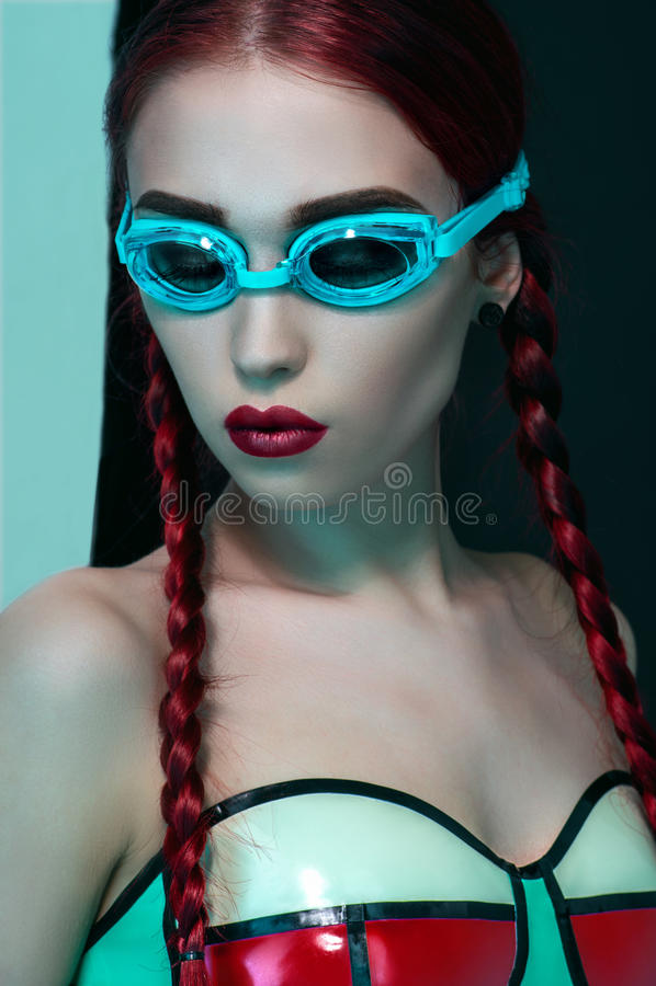 Fashion studio portrait of beautiful redhead woman royalty free stock photo