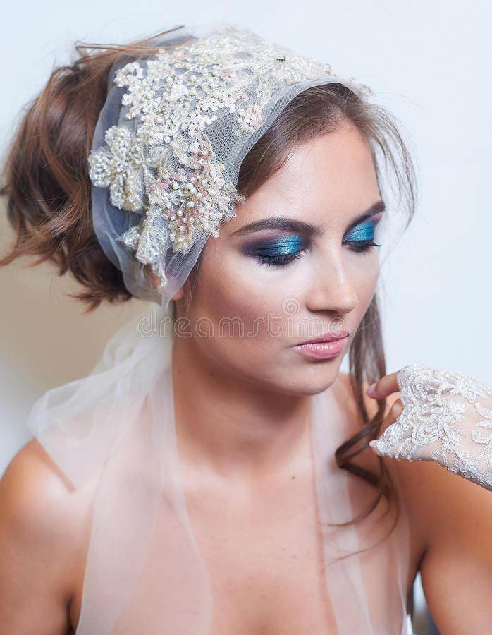 Fashion studio portrait of beautiful young bride with make up and in elegant gloves stock photo