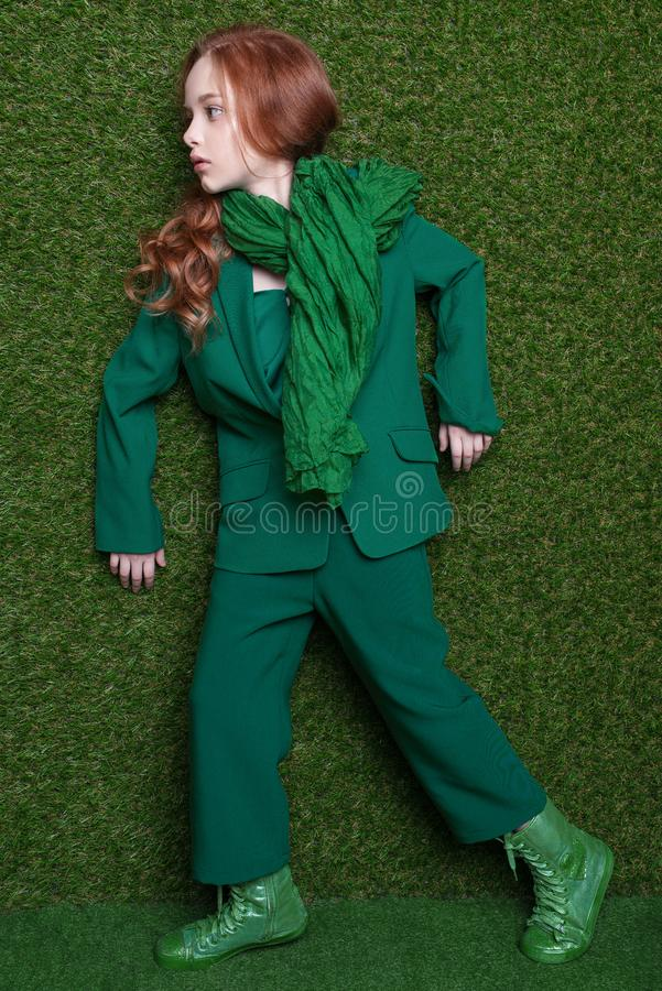 Free Fashion Studio Portrait Of Cute Little Redhead Girl Wearing Green Clothes. Royalty Free Stock Photos - 115010048