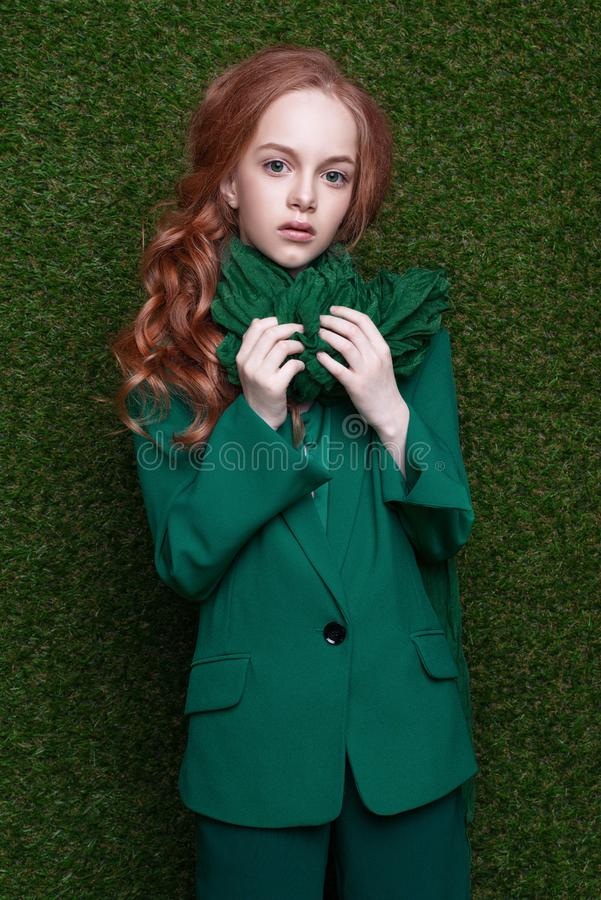 Free Fashion Studio Portrait Of Cute Little Redhead Girl Wearing Green Clothes. Stock Photos - 115010133