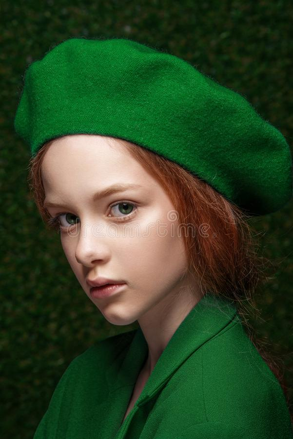 Free Fashion Studio Portrait Of Cute Little Redhead Girl Wearing Green Clothes. Stock Images - 116064744