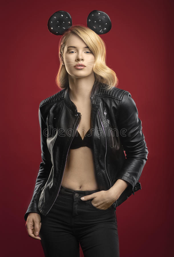 Fashion studio portrait of pretty blond in black jacket royalty free stock images