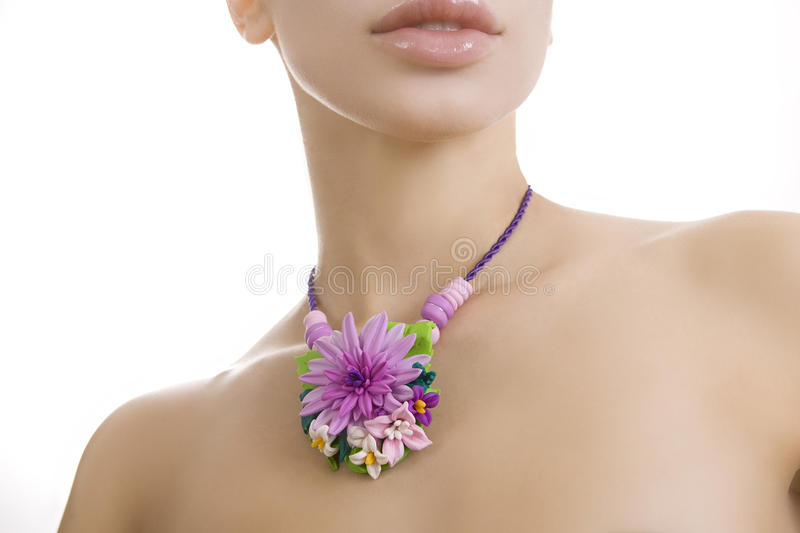 Fashion studio shot of beautiful woman with a floral handmade ne stock photo