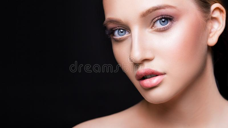 Fashion studio shot of beautiful young woman with make-up. Close-up portrait. Cosmmetology, beauty and skin care concept royalty free stock photos