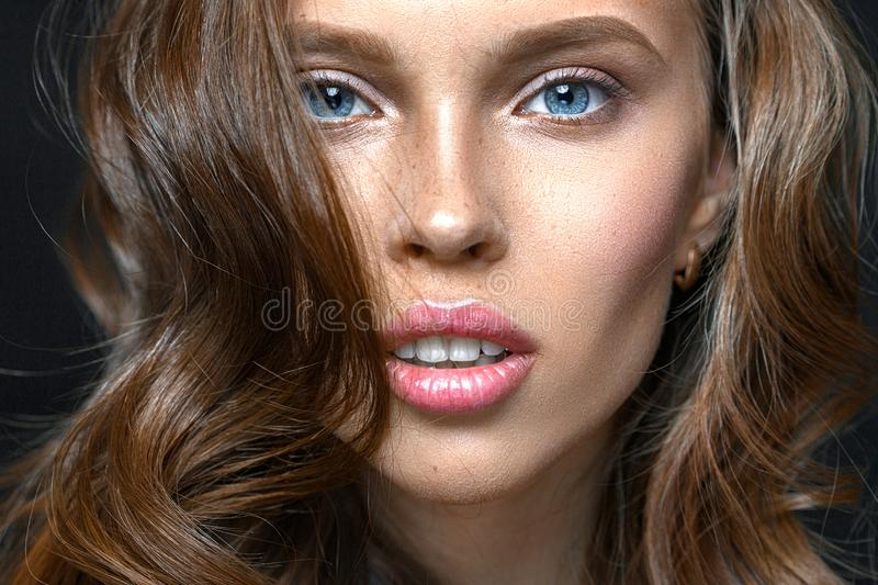 Fashion studio shot of beautiful young woman with make-up. Close-up portrait. royalty free stock photo