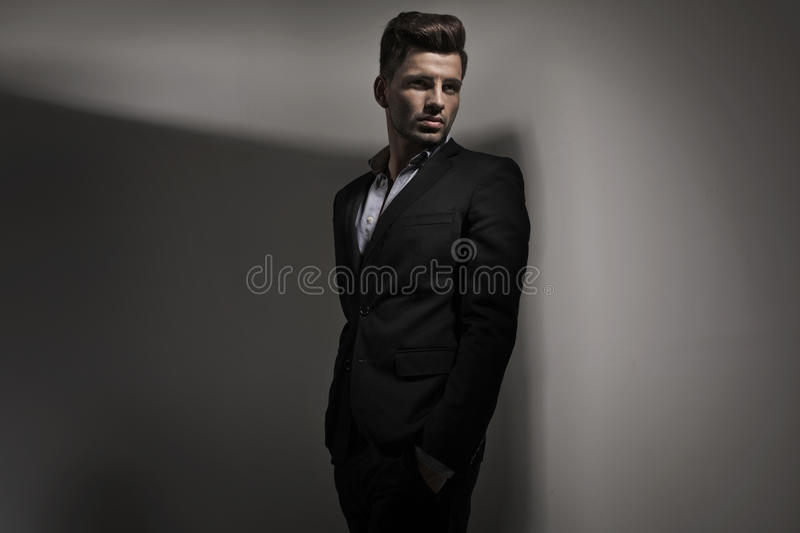 Fashion style photo of young guy. Dressed in suit royalty free stock photography