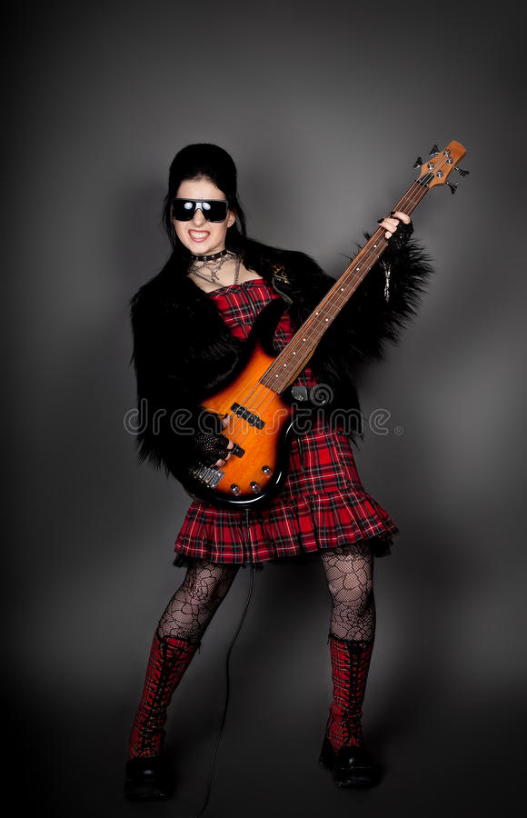 Fashion style photo of young woman with guitar. Series. Fashion style photo of young rocked woman in studio with guitar stock image