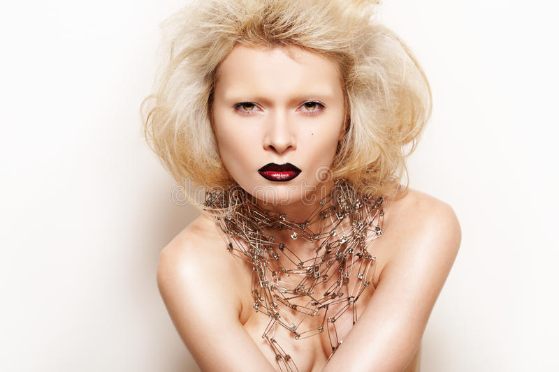 Fashion style. Rock lady with make-up, necklace stock photography