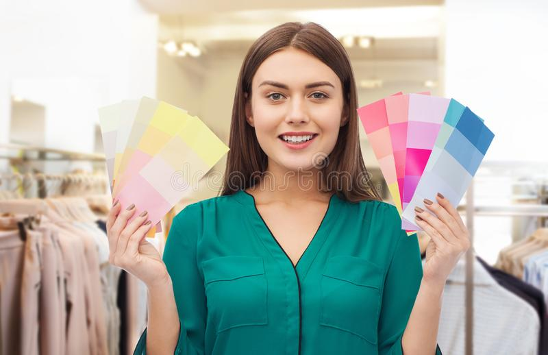 Woman with color swatches at clothing store stock photography