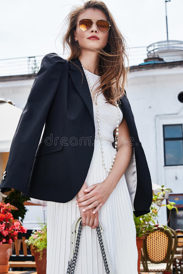 Fashion style street look elegant brunette woman walk cafe restaurant date meeting businesswoman success wear white dress and royalty free stock photography