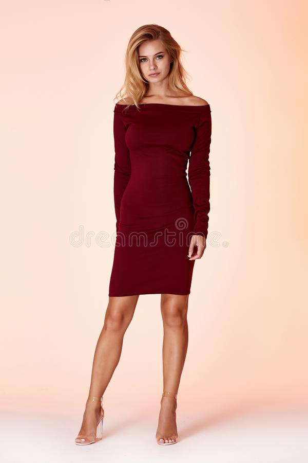 Fashion style woman perfect body shape blond hair wear dress code elegance casual beautiful model secretary air hostess diplomatic. Protocol office uniform royalty free stock photography