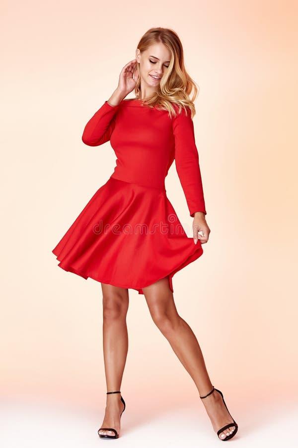 Fashion style woman perfect body shape blond hair wear red skinny short dress elegance casual beautiful model secretary. Office uniform stewardess business lady royalty free stock images