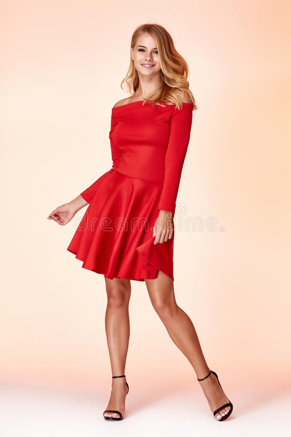 Fashion style woman perfect body shape blond hair wear red skinny short dress elegance casual beautiful model secretary. Office uniform stewardess business lady stock photos