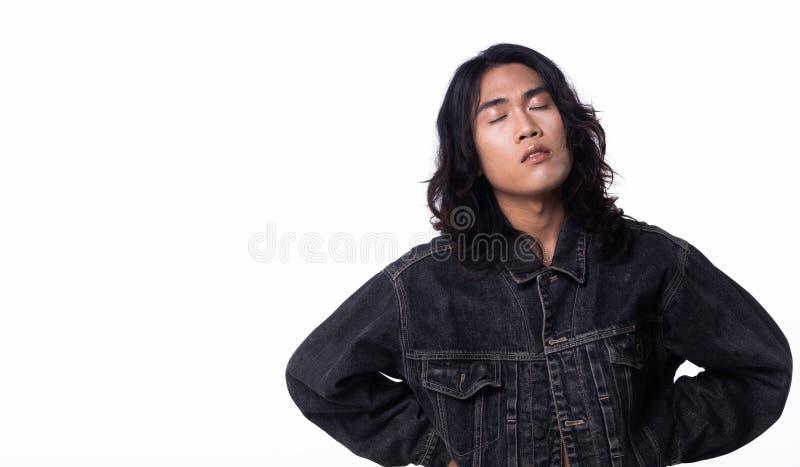 Fashion Stylish boy pose agindo em Jean Jacket fotografia de stock royalty free