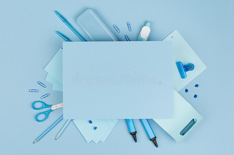 Fashion stylish workplace - neon blue office stationery collection and blank paper for text on pastel background, top view. Fashion stylish workplace - neon stock photos
