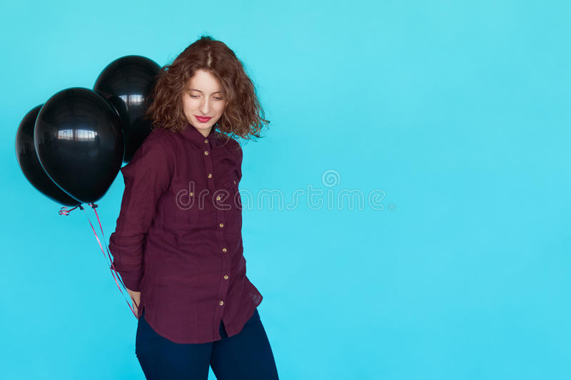 Fashion stylish young lady with black balloons royalty free stock photos