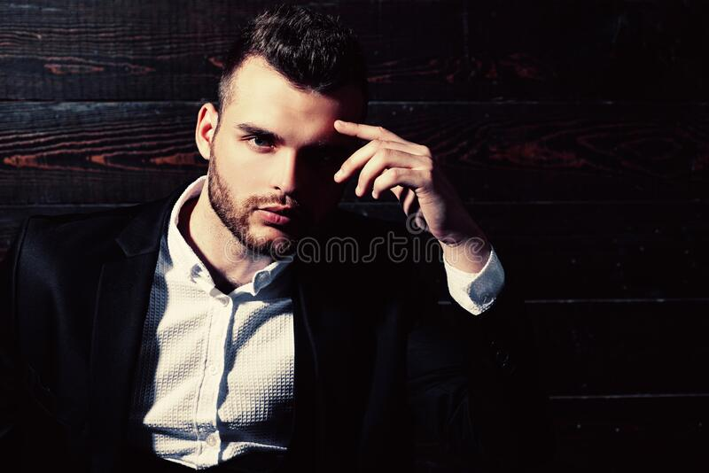 Fashion suit. Luxury mens clothing. Classic costume and trend. Rich man in classic suits. Man in suit. Businessman. Confidence. Classical costume. Mans Fashion stock photography