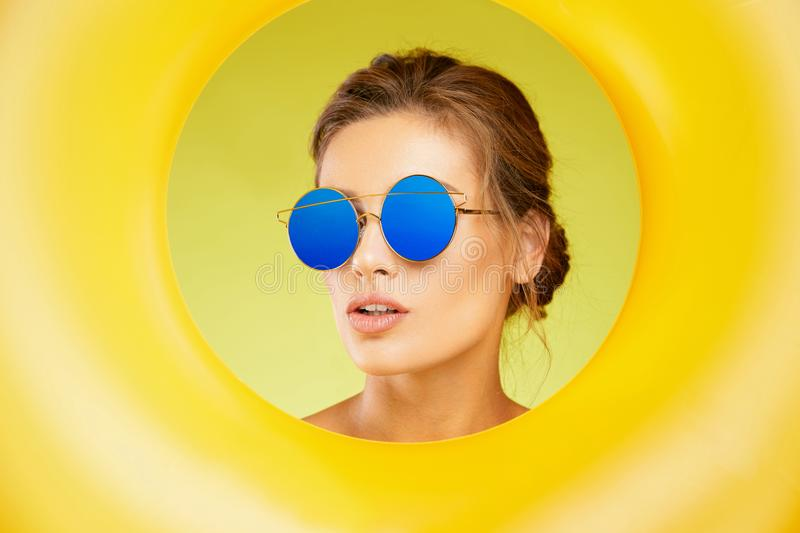 Fashion Sunglasses. Beautiful Woman With Colorful Sun Glasses stock images
