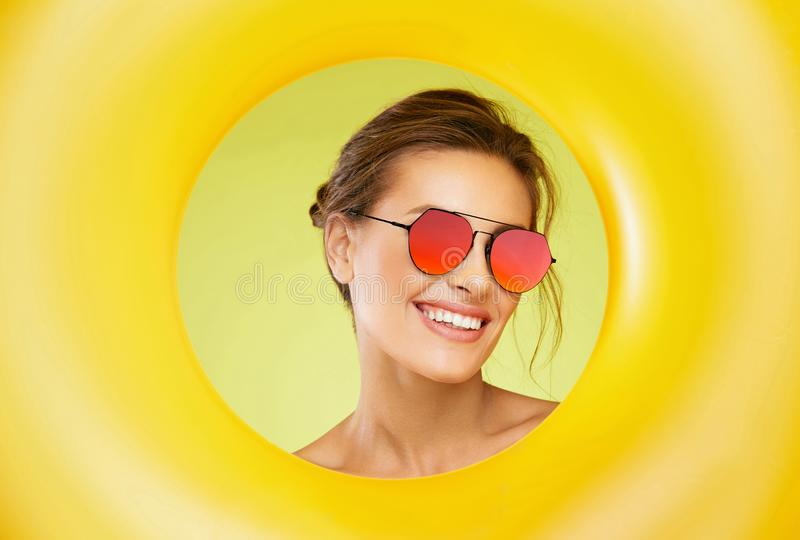 Fashion Sunglasses. Beautiful Woman With Colorful Sun Glasses royalty free stock image
