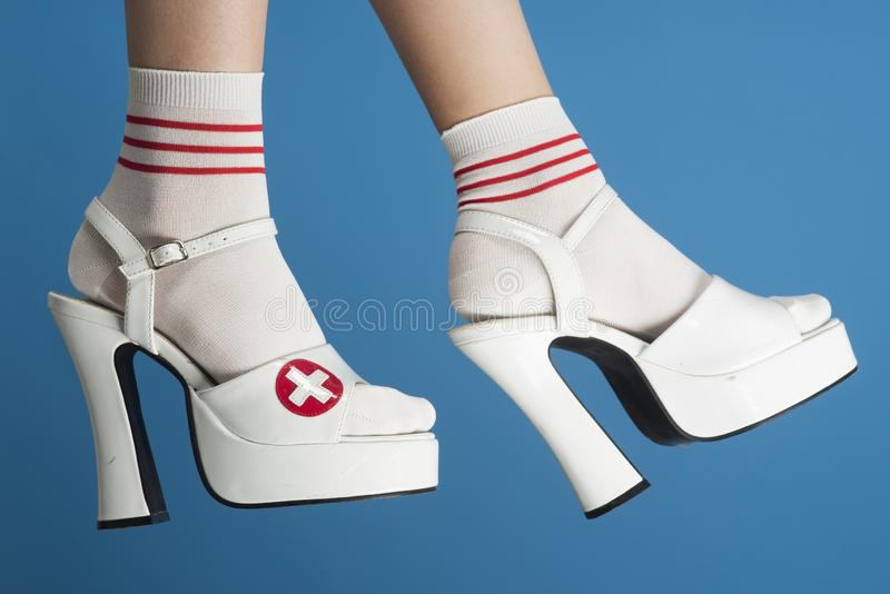 Fashion. Switzerland. White sandals in high heels. Shoes for women. stock photography