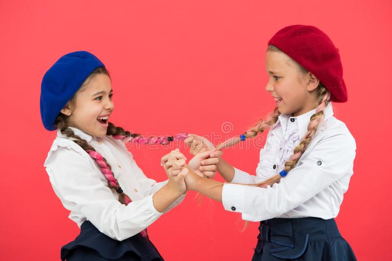 Fashion trend. It is awesome dye hair fun colors. Appropriate hairstyle. Keep hair braided for tidy look. Pupils with. Long braided hair. Hairdresser salon royalty free stock photography