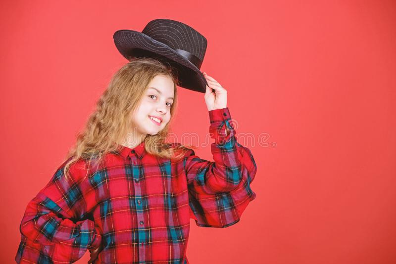 Fashion trend. Feeling awesome in this hat. Girl cute kid wear fashionable hat. Small fashionista. Cool cutie. Fashionable outfit. Happy childhood. Kids fashion royalty free stock images