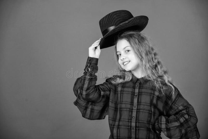 Fashion trend. Feeling awesome in this hat. Girl cute kid wear fashionable hat. Small fashionista. Cool cutie. Fashionable outfit. Happy childhood. Kids fashion royalty free stock photos