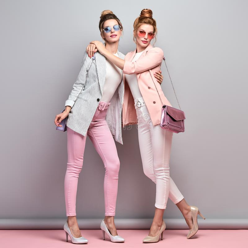 Two Fashion autumn having fun, Trendy fall outfit royalty free stock image
