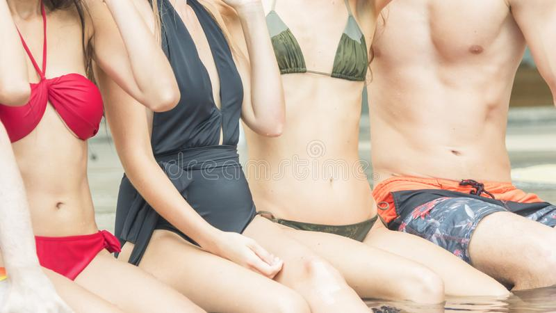 Fashion of underwear summer beach bikini slim muscle women and m. The Fashion of underwear summer beach bikini slim muscle women and men people sit in the royalty free stock photos