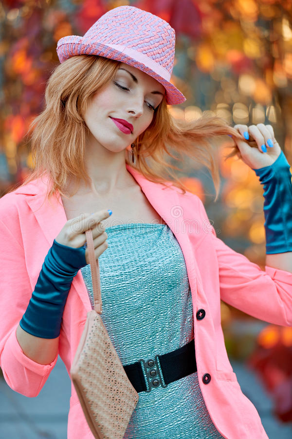Fashion urban people, woman, outdoor. Lifestyle. Fashion urban beauty people, smiling woman, outdoor. Playful glamor hipster redhead girl. Stylish hat vivid royalty free stock images