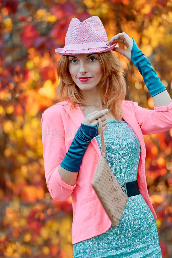 Fashion urban people, woman, outdoor. Lifestyle. Fashion urban beauty people, smiling woman, outdoor. Playful glamor hipster redhead girl. Stylish hat vivid royalty free stock photography