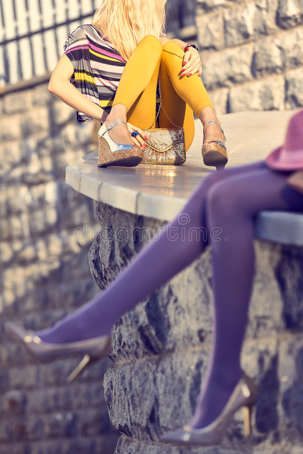 Fashion urban people, womans,outdoor. Lifestyle. Fashion urban beauty people friends,outdoor.Womens legs, pantyhose, stylish shoes, clutches.Playful hipster stock images