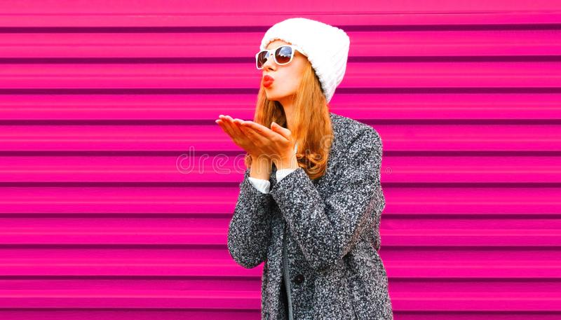 Fashion, Valentine`s day concept - beautiful woman blowing red lips sends an air kiss royalty free stock photos