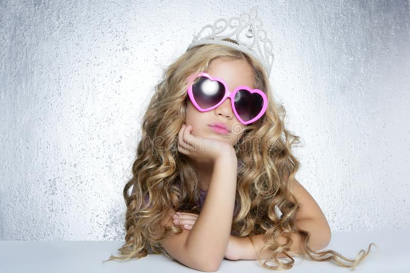 Fashion victim little princess girl portrait. Fashion victim little princess girl humor portrait crown and hearth shape glasses stock photography