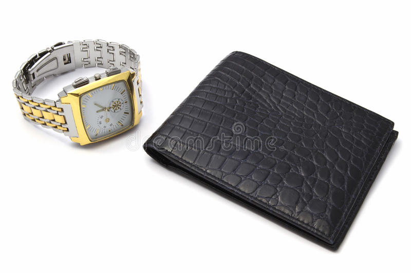 Fashion watch and wallet. Closeup on white background royalty free stock photo