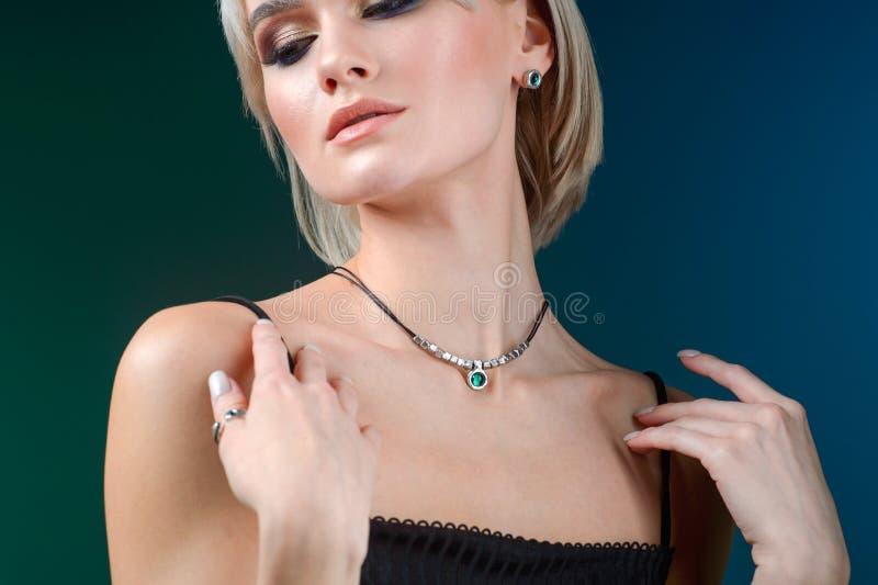 Fashion wear. Beauty trends. Beautiful fashion woman with jewelry. Fashionable jewelry, earrings. Beautiful model girl. Beauty royalty free stock image