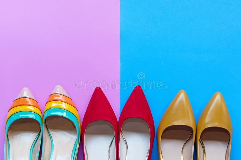 Fashion woman accessories set. Trendy color full fashion shoes heels. Pink and blue pastel color background. Fashion Concept royalty free stock photo