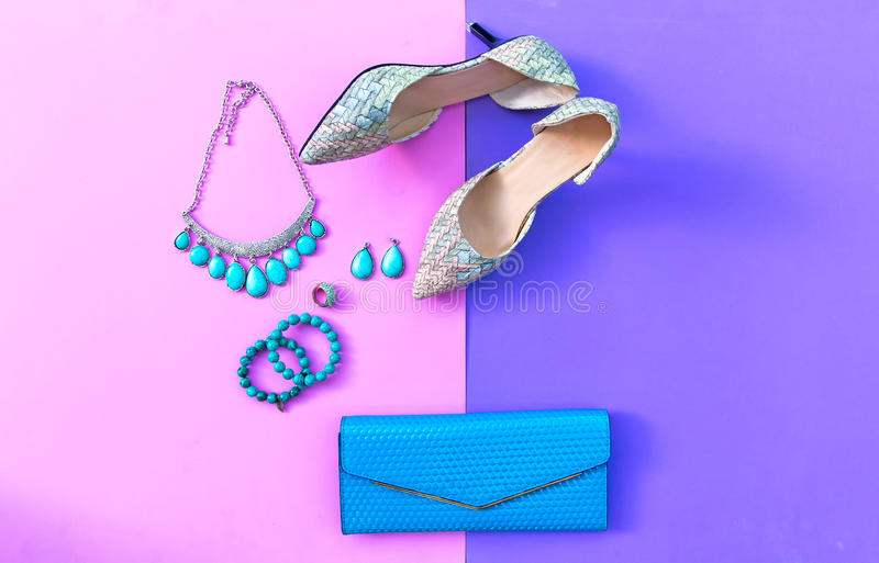 Fashion woman accessories set. Trendy fashion shoes heels, stylish handbag clutch, necklace, bracelet and ring. Lifestyle Concept stock image