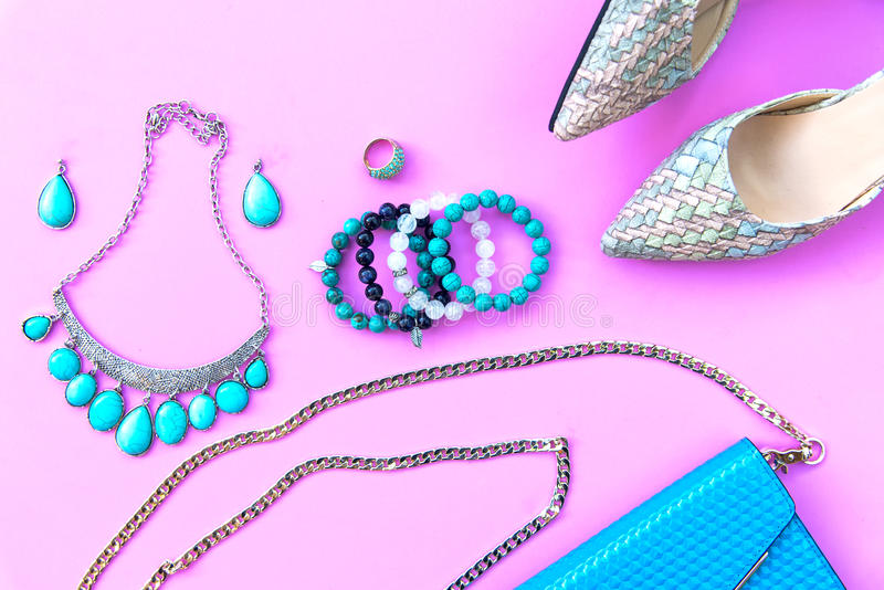 Fashion woman accessories set. Trendy fashion shoes heels, stylish handbag clutch, necklace, bracelet and ring. Lifestyle Concept royalty free stock photo