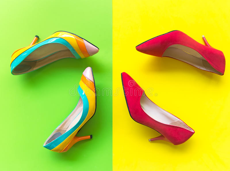 Fashion woman accessories set. Trendy fashion red and yellow shoes heels, stylish. Colorfull green and yellow background. Lifestyle Concept stock photography