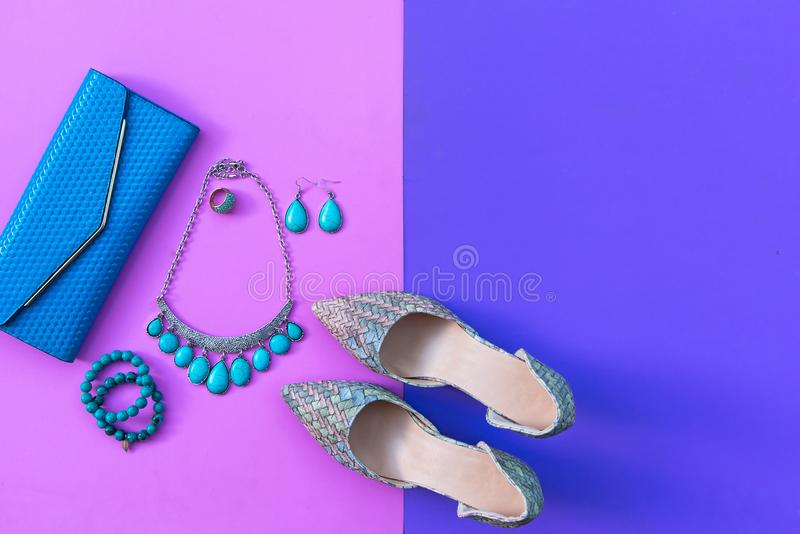 Fashion woman accessories set. Trendy fashion shoes heels, stylish handbag clutch, necklace, bracelet and ring, pink and purple ba stock photos
