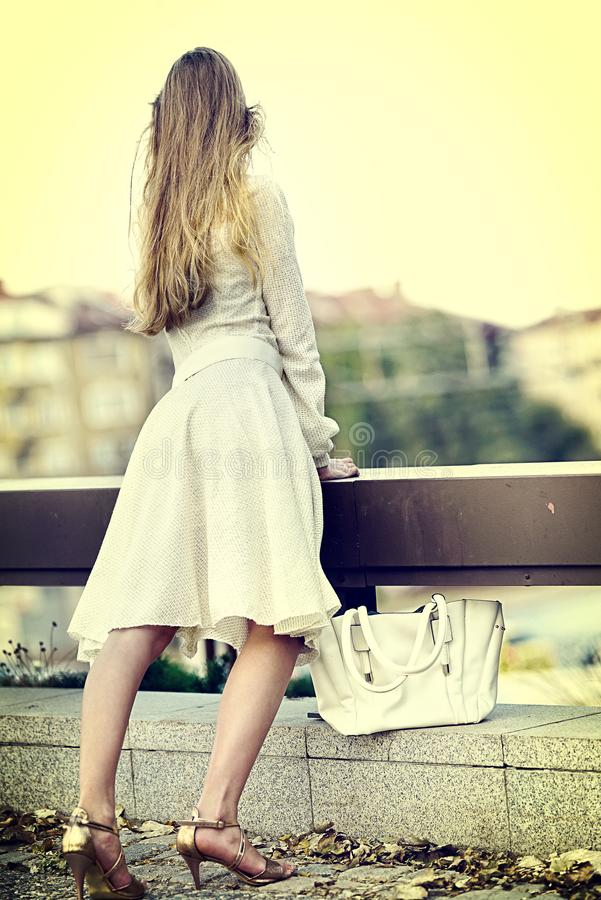 Fashion woman in autumn spring dress on city . Sosial isoltion. stock image
